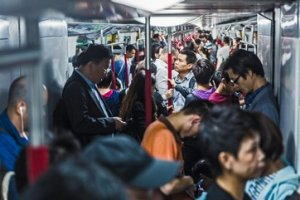 Commuters packed on underground train, Hong Kong, China